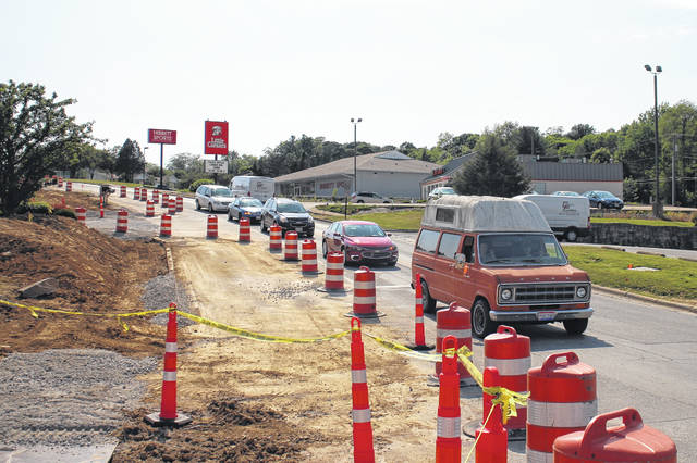 A road-widening project on Harry Sauner Road in Hillsboro has traffic slowed at the intersection of Harry Sauner and U.S. Route 62. The project is slated to continue until October.