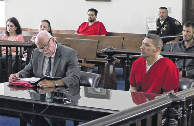 Steve Davis, right, sits in Highland County Common Pleas Court on Wednesday with attorney Bill Armintrout.