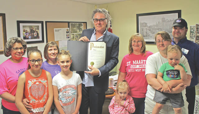 Hillsboro Mayor Drew Hastings on Monday proclaimed June 23 Relay for Life Day in Hillsboro. The relay, an annual benefit for the American Cancer Society, will be held June 23 at the Highland County Fairgrounds in Hillsboro. Shown from left to right are Relay for Life representatives Brenda Coleman, Kyleen Nevels, Dorothy Parsons, Jadyn Poppaw, Hastings, Brooklyn Edenfield, Augie Poppaw, Renee Poppaw, Jase Edenfield and Greg Baker of Kroger, a sponsor of the event.