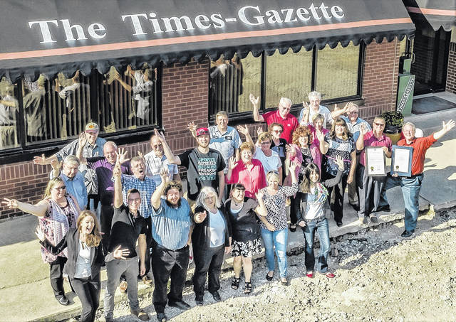 Former and current Hillsboro and Greenfield newspaper employees and elected officials gathered on the steps of The Times-Gazette Monday for a group photo on the 200th anniversary of The Times-Gazette's founding on June 18, 1818. Highland County Commissioner Shane Wilkin and Times-Gazette Publisher Gary Abernathy are shown at lower right holding proclamations Wilkin brought from the commissioners and State Sen. Bob Peterson. Former publishers on hand were Pamela Stricker and Phil Roberts. Others on hand for the photo were Katie Wright, David Wright, Ryan Applegate, Brenda Earley, Sarah Davidson, Lora Abernathy, Ann Runyon-Elam, Chuck Miller, Jeff Gilliland, Robert Stegbauer, Pat Lawrence, David Heaton, Sharon Hughes, Tracie Guisinger, Jeff Duncan, Leland Pennington, Terry Washburn, Ed Everhart, Ron Coffey, Sharon Bell, Beverly Ball Ries and Melissa Rickman.