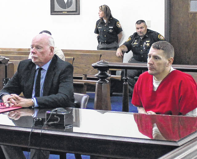 Steve Davis, right, sits in Highland County Common Pleas Court on Monday with defense attorney Bill Armintrout.