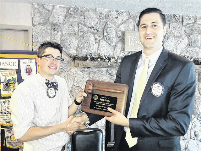 The Hillsboro Rotary Club held installation ceremonies this month, with a change in president and various honors awarded. Above, Matt Greene, right, new Rotary president, presents outgoing president Reid Sharp with a plaque in appreciation of Sharp's service over the past year.