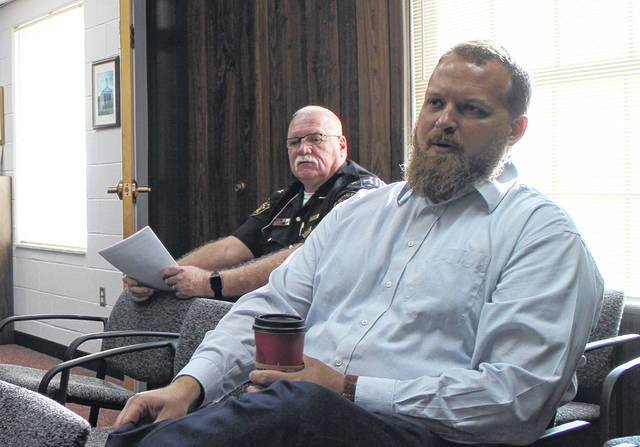 Highland County Health Commissioner Jared Warner, foreground, speaks to county commissioners on Wednesday. Shown in the background is Sheriff Donnie Barrera.