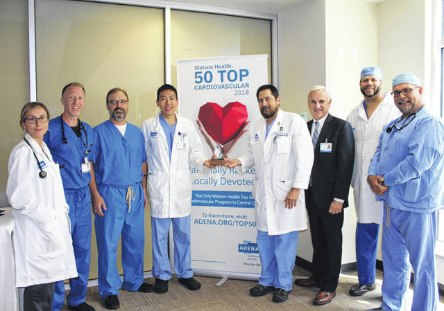 Adena Health System cardiovascular providers and president and CEO Jeff Graham are pictured with their Top 50 Heart Hospital Award.