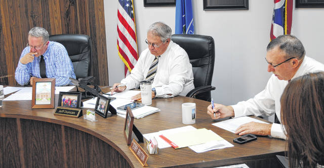 The Highland County Board of Commissioners is pictured at Wednesday's meeting, from left, Gary Abernathy, Jeff Duncan and Terry Britton.