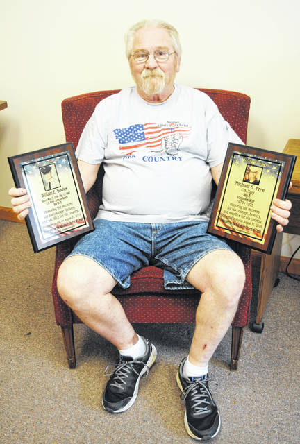 Don Bowles holds a couple of the plaques he will present during a ceremony Friday in Rainsboro.