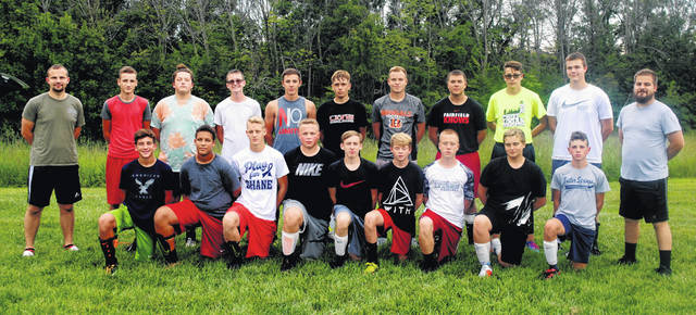 The Fairfield varsity boys soccer team and coaches pose for a group photo at Fairfield High School.