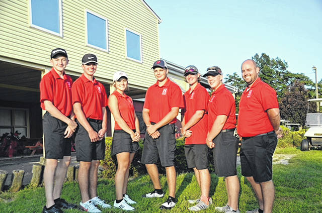 The Hillsboro Indians varsity Golf team poses for a photo at the Elks Golf Club in Hillsboro. Pictured (l-r): Lawton Parry, Gavin Puckett, Kristin Jamieson, Will Kiefer, Ryan Harless, Brennen Priest and Head Coach Nathan Boatman.