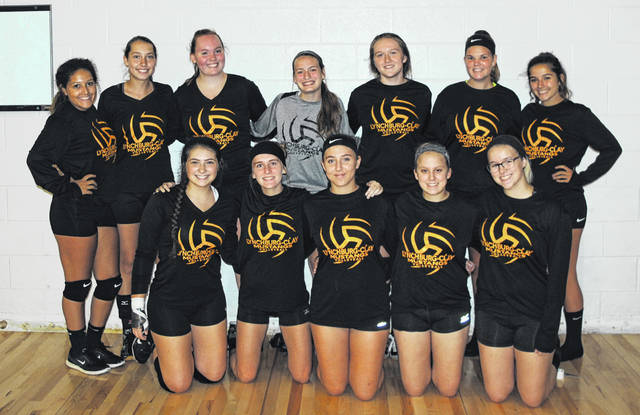 The Lynchburg-Clay Lady Mustangs volleyball team poses for a group photo before practice at Lynchburg-Clay High School.