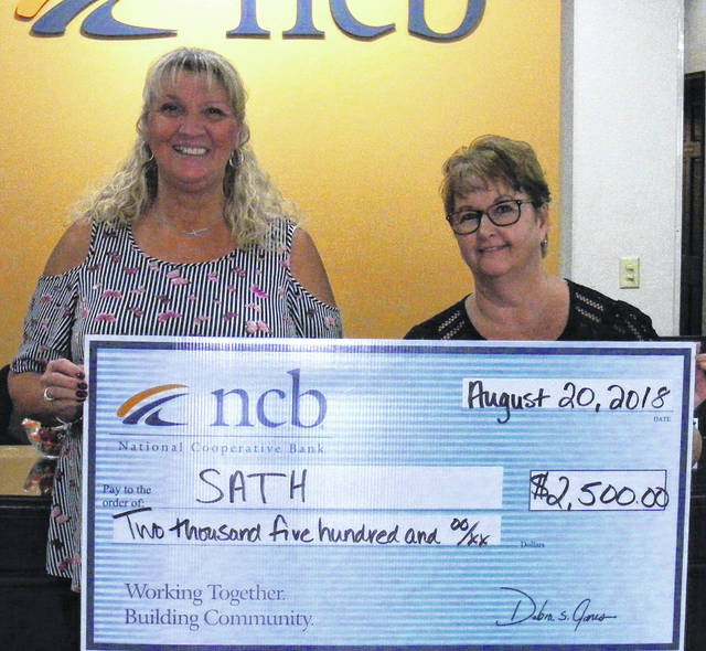 NCB recently donated $2,500 to Supplementary Assistance to the Handicapped (SATH) for its annual KAMP Dovetail, a summer camp for children with special needs. Pictured, from left, are Linda Allen, SATH executive director, and Tammy Irvin, NCB branch manager.