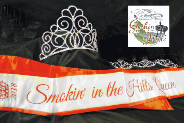 The sash and tiaras someone will claim at the Smokin' in the Hills Queen Scholarship Pageant are shown.