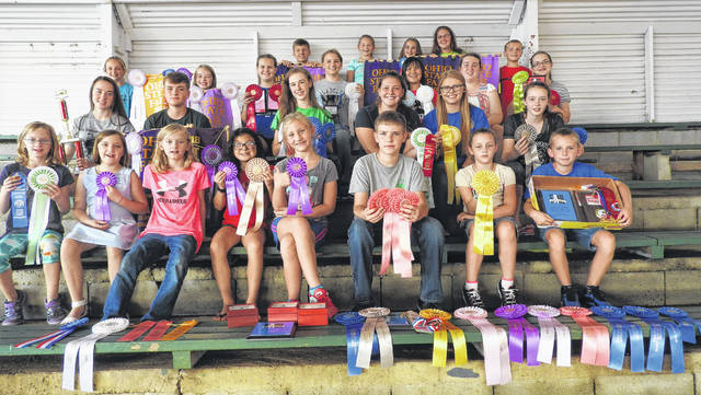 Highland County was well represented at the 2018 Ohio State Fair. Many ribbons, banners and awards were won by our 4-H members. Pictured are some of the state fair winners These individuals, along with all Highland County 4-H members, spend countless hours on their projects. Many people only recognize the animal projects however, each member has over 200 projects from which to choose. Pictured are (back row, l-r) Caden Hess, All About Beef; Sydney Shelton, All About Beef; Emma Yochum, All About Beef; Heather Burba, Marshall Stockmen; and Cameron Burkhart, Marshall Stockmen (third fow, l-r) Katie Cook, Greene Countrie Farmhands; Maddie Caldwell, Fab 5; Katelyn Chambliss, Highland County Unlimited; Kathryn Ogden, Canine Commanders; Kyah Chaney, K-9 Commanders and Fantastics; Alexis West, Marshall Jr. Farmers; and Madison Frazer, Fur, Feathers and Friends (second row, l-r) Hope Wyckoff, Barnyard Bunch; Spencer Wyckoff, Barnyard Bunch; Sydney Hamilton, Highland County Poultry, Pigs and Lambs; Claire Wilkin, Fur, Feathers, and Friends; Kelsey Thornburg, Fur, Feathers, and Friends; and Destinee Kipp, Fur, Feathers, and Friends (front row, l-r) Eve Roehm, Highland Harvesters; Leah Robinson, Marshall Stockmen; Mia Roehm, Highland Harvesters; Jayah Chaney, Fantastics; Lizzy Ogden, K-9 Commanders, Sam Hamilton, Highland County Poultry, Pigs and Lambs; Siarra Kipp, Fur, Feathers, and Friends; and Gage Thompson, Fur, Feathers and Friends.