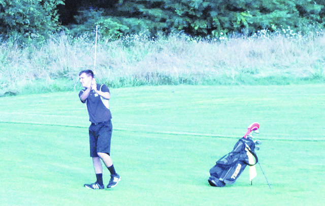 McClain Trenton Newkirk hits his second shot on the second hole at Buckeye Hills Country Club in Greenfield on Thursday, August 9, where the Tigers battled Madison Plains in a non-conference golf match. The Tigers placed second on Saturday, August 11, in the Unioto Invitational with a score of 172.