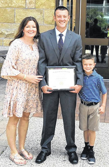 Chad Wilson (center), vice president/commercial banking manager at First State Bank, recently graduated from the Graduate School of Banking at the University of Wisconsin-Madison. He is pictured with his wife, Amie, and son, Krew.