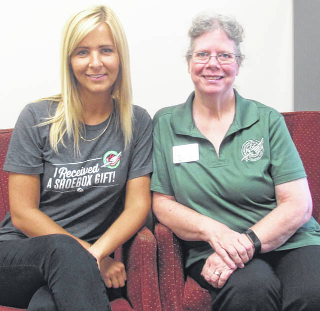 Nadia Karnatova, left, an Operation Christmas Child shoebox recipient from Ukraine, is shown with Barb Lanctot, OCC coordinator for the South Central Ohio Area.