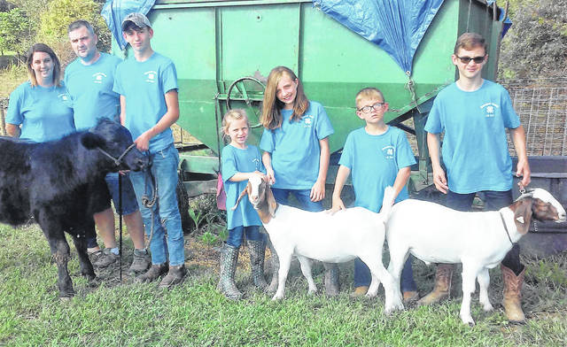 Amanda, Eric, Jared, Britney, Annie, Braxton and Connor Hendersonare pictured with their animals, getting ready for this year's Highland County Fair.
