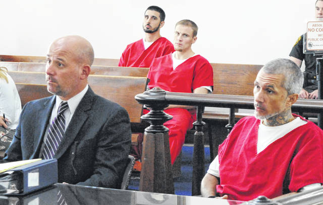 Stoney Behler, right, sits in Highland County Common Pleas Court on Wednesday with attorney J.D. Wagoner.