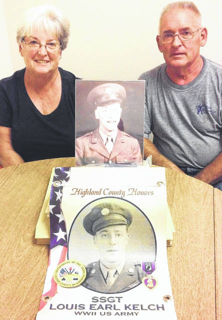 Cheryl Lyle and Daryl Kelch are pictured with mementos of their father, U.S. Army Air Corps Staff Sgt. Louis Kelch.