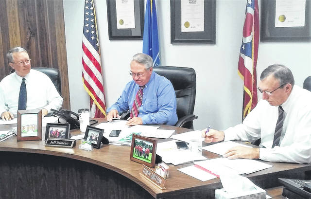 Highland County Commissioners Gary Abernathy, Jeff Duncan and Terry Britton are shown in regular session Wednesday voicing their unanimous opposition to State Issue One.