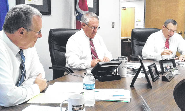 Highland County Commissioners, from left, Gary Abernathy, Jeff Duncan and Terry Britton, are pictured during Wednesday's meeting agreeing to let a Department of Justice grant application deadline expire for the Rocky Fork Lake area.