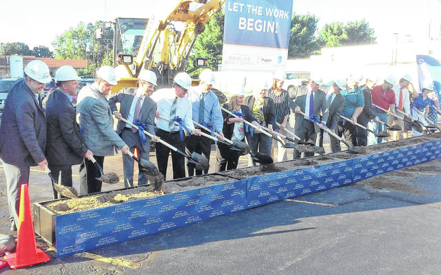Management and staff at Highland District Hospital take part in the groundbreaking ceremonies Thursday for the $21.5 million planned renovations and additions to the Hillsboro facility.