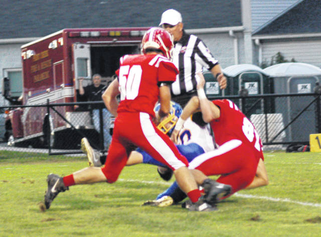 Hillsboro's Luke Middleton (81) tackles a Rockets ball carrier as Richard Adkins (50) also gives chase on Friday at Richard's Memorial Field in Hillsboro.