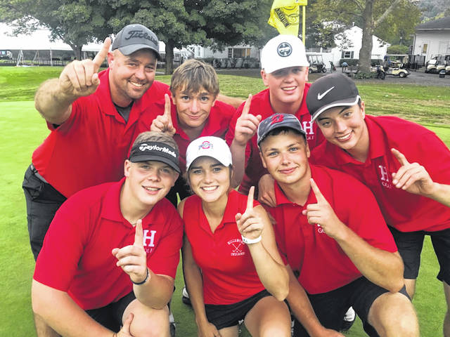 The Hillsboro boys varsity golf team members each hold up one finger on Thursday at Chillicothe Country Club where they won their final FAC match of the season and wrapped up the FAC boys golf championship.