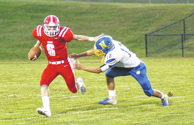 Hillsboro's Mason Swayne stiff arms a Clermont Northeastern defender on Friday at Richard's Memorial Field in Hillsboro where the Indians battled the Rockets in high school football action.