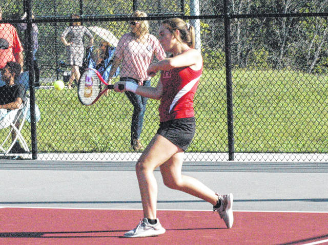 Hillsboro's first singles competitor swings her racket during a volley on Thursday at Hillsboro High School where the Lady Indians battled the Lady Cavaliers.