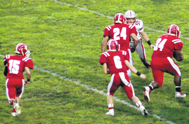 Hillsboro's backfield of Mason Swayne (6), Josh Keets (24) and Deon Burns (34) powered the Indians to a convincing 49-0 victory over East Clinton on Friday in their first home game of the season.