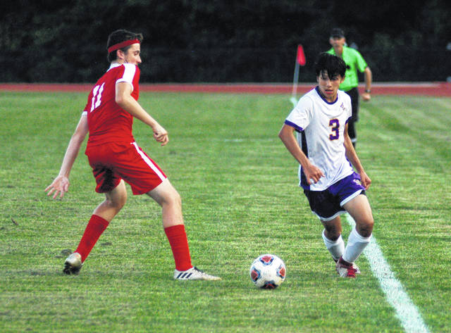 McClain's Luke Sanchez works along the sideline against Hillsboro's Hunter Hice on Tuesday at Hillsboro High School where the Tigers battled the Indians in a FAC soccer showdown.