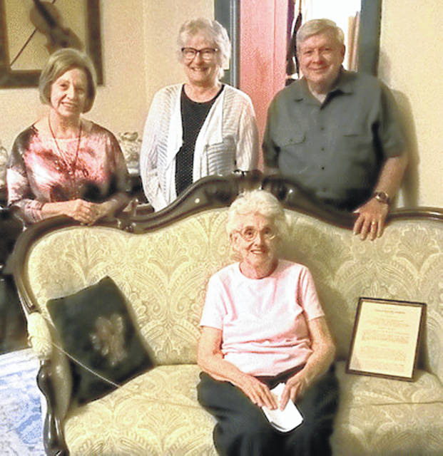 Pictured at the Highland House Museum on East Main Street in Hillsboro are: Jean Wallis (seated) and (standing, l-r) Nancy Wisecup, Carolyn Hastings and Jim Rooney.