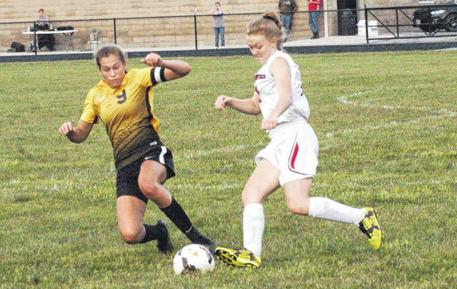 Lynchburg-Clay's Peyton Scott attempts to take the ball from an Eastern player on Wednesday at Lynchburg-Clay High School where the Lady Mustangs hosted the Lady Warriors in a SHAC match.