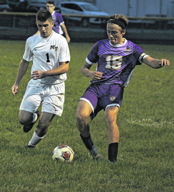 McClain's Reece Schluep (15) had the lone goal for the Tigers on Tuesday against Miami Trace. Defending is Panther Kyler Conn.