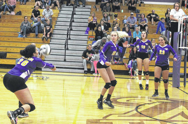 McClain's Makenzie Montavon (26), Maddy Crawford (10), Taylor Butterbaugh (13) and Kaleigh Easter (23) are pictured during Tuesday's match against Miami Trace.