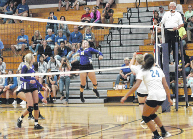 Jaelyn Pitzer (14) of McClain jumps to spike the ball Tuesday at McClain High School where the Lady Tigers battled Chillicothe in FAC volleyball action.