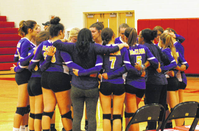 The McClain Lady Tigers volleyball team huddles at Hillsboro High School during the second set of their FAC volleyball match against the Lady Indians.