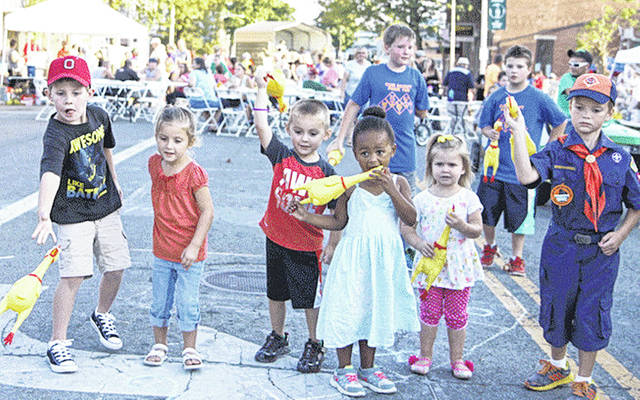Youngsters are pictured taking part in the chicken toss contest during a past G3, Grow Greater Greenfield Oktoberfest.