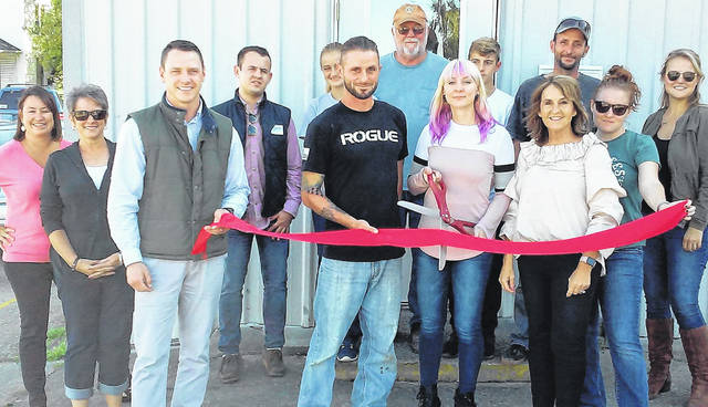 The Hillsboro Chamber of Commerce and other well-wishers celebrate the grand opening of Bilancia Tattoo and Permanent Makeup with a traditional ribbon-cutting ceremony Friday afternoon.