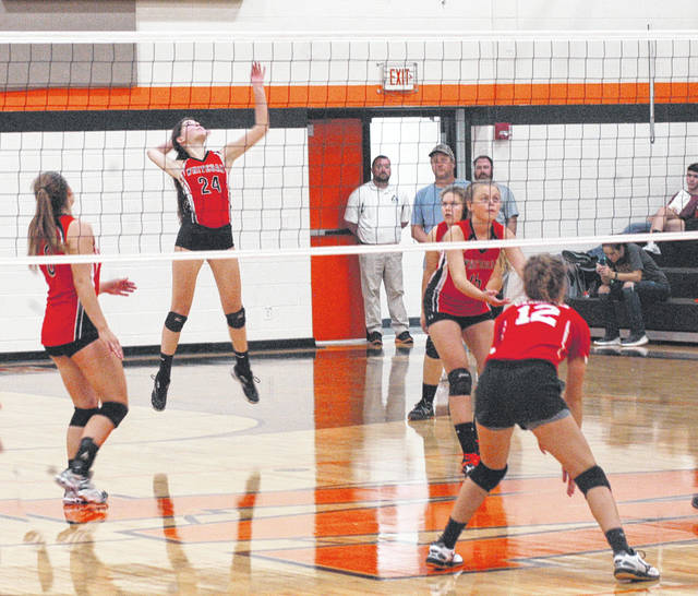 Whiteoak's Macy Knoblauch (24) prepares to hit the ball on Thursday at Whiteoak High School where the Lady Wildcats battled the Felicity Lady Cardinals in volleyball action.
