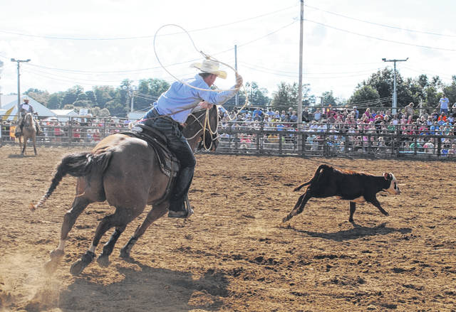 This cowboy winds up to rope a calf during the rodeo at the Highland County Fair Sunday afternoon.