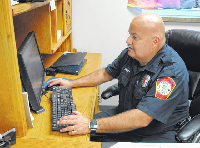 Jerry Quigley, Paint Creek Joint EMS/Fire District's fire inspector, is shown in his office at Paint Creek's Hillsboro station.