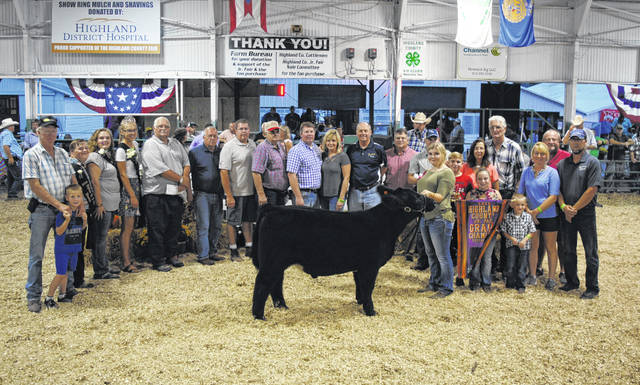 Emma Parry's Grand Champion Feeder Calf Steer sold for $11.25 per pound Friday night at the Highland County Fair. The buyers were A-1 Buildings, Bohrer Veterinary Services, Cundiff's Tree Care, Dickey Group Realtors, Herdman's Pole Barns, Landscapes & Outer Spaces LLC, Mark and Lannae Greene, Master Feed Mill of Hillsboro, Merchants National Bank Hillsboro, NCB, Nathan Mootz LG Seeds, Parry Show Cattle, Ponderosa Steakhouse, Shaun and Tom Dance Fencing & Excavating, Sibrel Excavating Co. Inc., Southern Hills Community Bank Leesburg, Tim Boler Home Inspections, Union Stockyards, Weller's Plumbing & Heating Inc. and Tony and Shannon Wetherington.