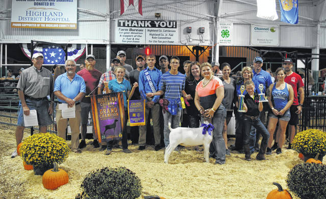 Ashlie Hillyer's Grand Champion Overall Market Boer Goat, which also won County Bred and Born honors, sold for $41 per pound Wednesday night at the Highland County Fair. It was purchased by Bonnie & Terry Britton, Buckeye Denistry and Joseph Jordan DDS, Color Me Crazy, Cundiff's Tree Care, Evolve Strength and Conditioning, Fifth Third Bank, Higgins Steel Roofing, NCB, Rock Cliff Acres, Service Master, Turner and Sons Funeral Home, VFW Post 9094, Ventura Feed and Country Store, West Wind Property Maintenance and Burnett's Lawn Care.