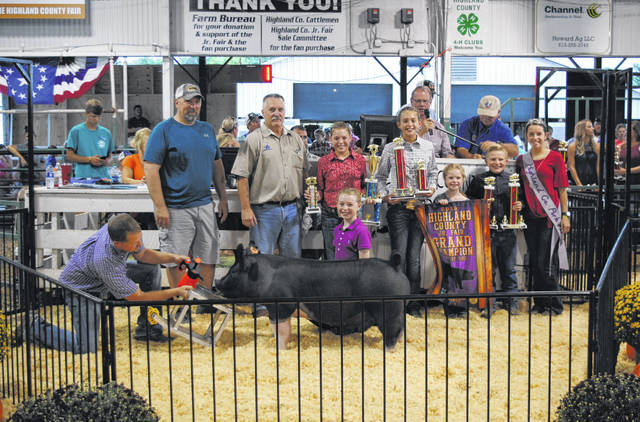 Maddie Caldwell's Grand Champion Market Barrow sold for $30 per pound Wednesday night at the Highland County Fair. It was purchased by Bednarski Farms.