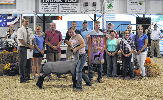 Paige Teeters' Reserve Grand Champion Market Lamb sold for $11 per pound Friday night at the Highland County Fair. The buyers were Farm Credit Mid-America, Jerry Haag Motors, NCB, Shelly Materials, Southern Hills Community Bank Leesburg and Terry's Grocery.