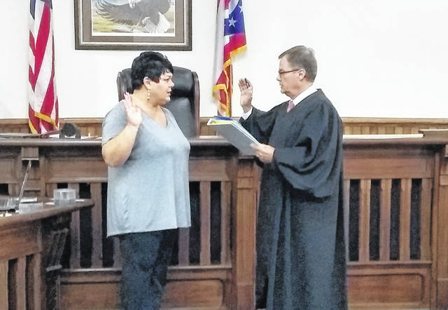 Highland County Common Pleas Court Judge Rocky Coss, right, swears in Heather Young, left, as the new Hillsboro City Treasurer on Monday. Young was appointed by the Highland County Democratic Party to replace Patricia Burns, who was elected to the seat in November and recently resigned to become the clerk for the Hillsboro Water Department. Young has a background in accounting, having served for a number of years in the University of Kansas comptroller's office. She is a licensed practical nurse and hairstylist, and resides in Hillsboro with her family. Young said she looks forward to serving her community as treasurer.