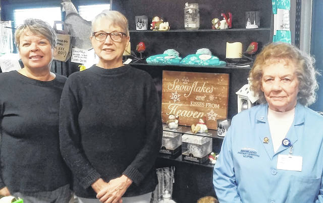 Highland District Hospital Gift Shop co-managers Cathy Jones and Pam Limes, and volunteer Loretta McNamee are shown getting ready for the gift shop's open house Nov. 1-3.