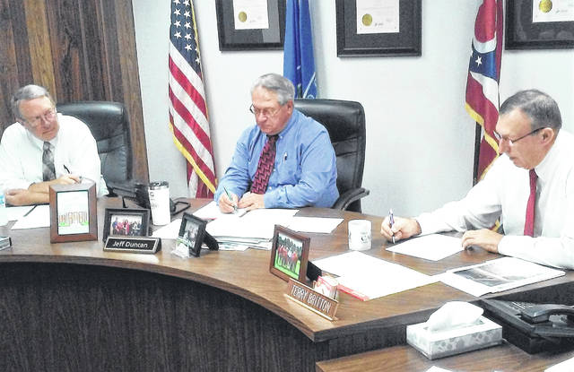 At Wednesday's meeting, Highland County commissioners, from left, Gary Abernathy, Jeff Duncan and Terry Britton, agreed to continue with their efforts at securing a Rocky Fork Lake area grant.