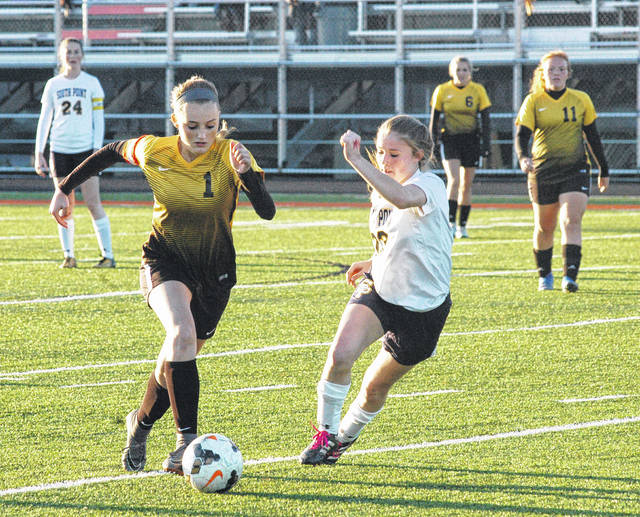 Lynchburg-Clay's Riley Creditt advances the ball downfield into South Point territory on Tuesday at Raidiger Field in Waverly where the Lady Mustangs took on the Lady Pointers in Southeast District Semifinal girls soccer action.